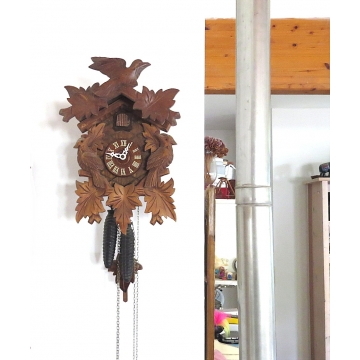 Black forest german cuckoo clock. Hand carved, vintage mechanical bird cuckoo clock